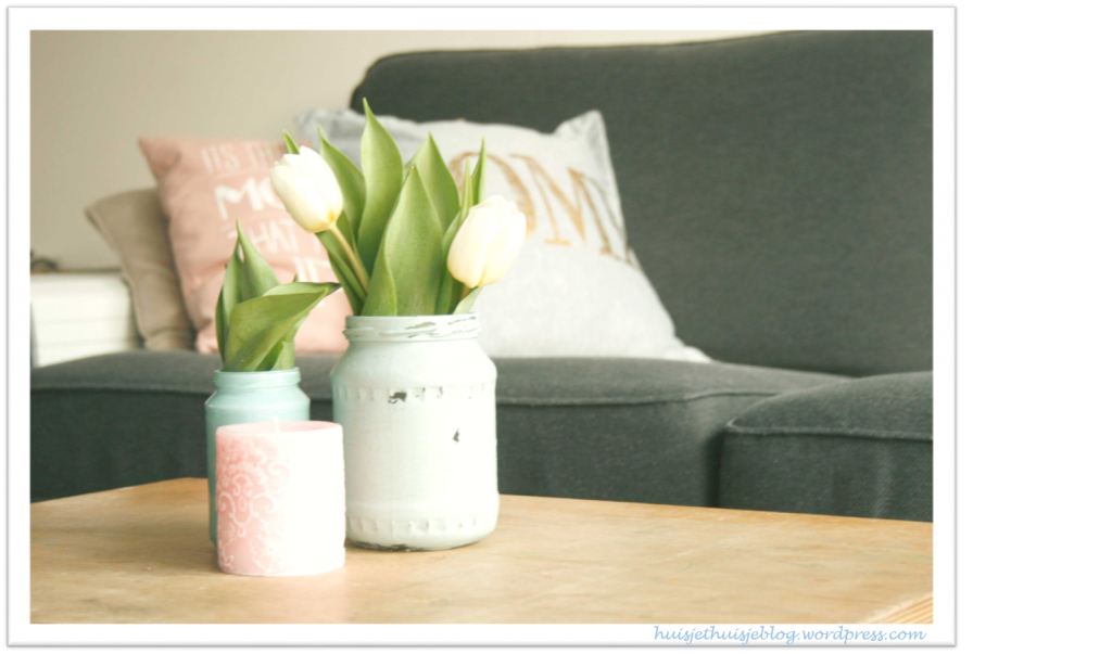 Painted jars on table